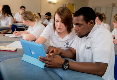 Two physiotherapy students using tablets