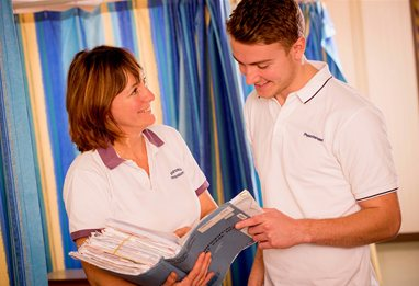 Physiotherapists discussing a patient file