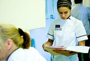 Podiatry student looking at patients notes with frown on her face