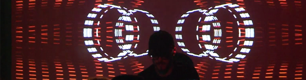DJ in front of visual display