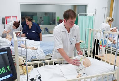 Nursing students training with dummies