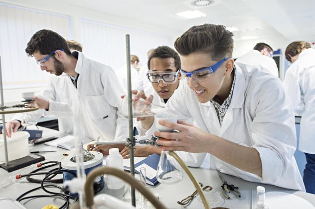 Chemistry students performing an experiment in the lab