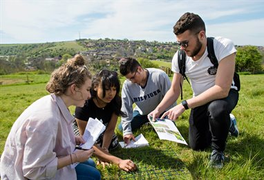 Ecology students on a field trip in a field