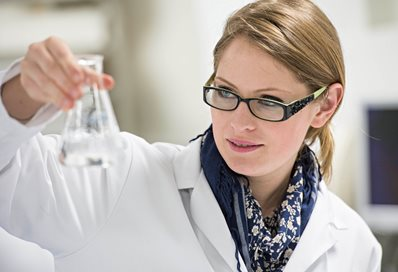 Pharmacy student working with a test tube