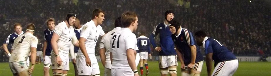 Photo of two rugby teams getting ready for scrum in a game.
