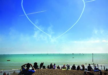 A heart in the sky made by aircraft trails at Eastbourne Airshow