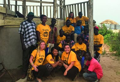 A group of people in Turtle SOS t-shirts in GAMBIA