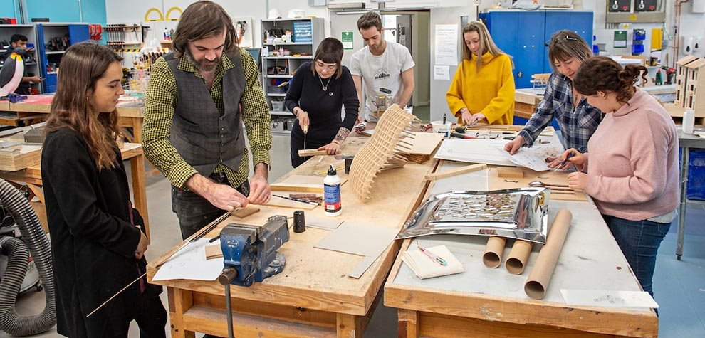 Students and staff working in the workshop
