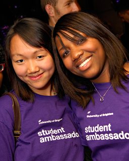 Two smiling students in purple 'student ambassador' tshirts
