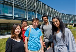 Smiling students at Checkland, Falmer campus