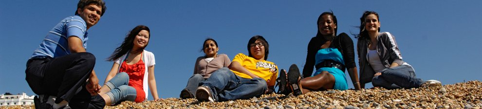 International students on Brighton beach