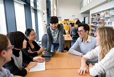 International students meeting in the library