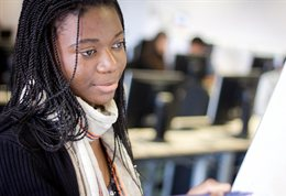 Close up of a student looking at her computer
