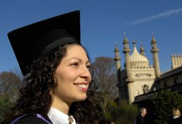 Graduate in mortar board in front of the Royal Pavilion