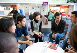 Students chatting round a table