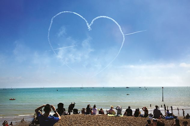 A heart in the sky above the sea at the airshow in Eastbourne