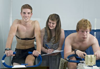 Students on sports lab cycling equipment