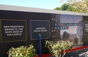 Hoardings around the Big Build campus development