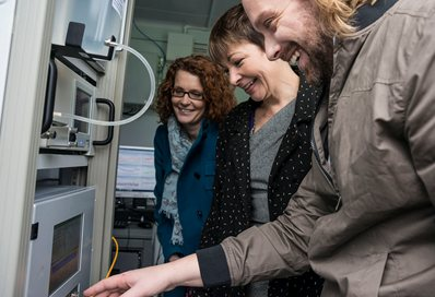 Dr Kirsty Smallbone, MP Caroline Lucas and Dr Kevin Wyche inside the air quality monitoring station