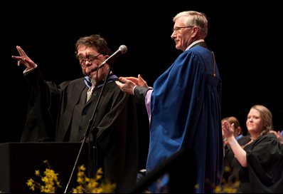 Adam receives his award from John Harvey, Chairman of the university's Board of Governors.