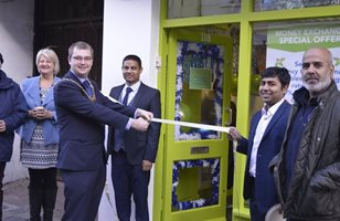 Mayor of Worthing, Alex Harman, opened the shop. Mohammad is in the centre.