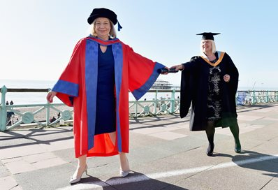 Passing the baton - Sarah Hogg presents Jennie Price with her Honorary Doctor of Letters