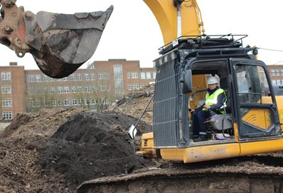 Vice-Chancellor Professor Humphris takes the controls of an excavator