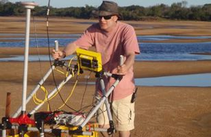 Professor Phil Ashworth using ground penetrating radar for flood research