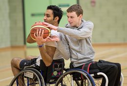 Two wheelchair basketball players